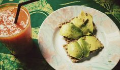 Healthy snack of papaya, mango, passion fruit and tree tomato juice smoothie with avos on ryvitas.