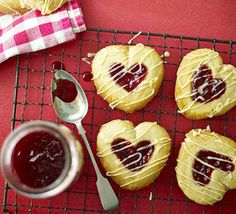 Jammy heart drops Cook from the heart and serve these raspberry-centred biscuits to kids, young and old- you don't need a special cutter, either Bbc Good Food Recipes, Baking Recipes, Cookie Recipes, Baking Ideas, Biscuit Recipes Uk, Uk Recipes, Party Recipes, Party Snacks, Recipies
