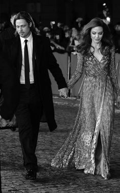 Angelina Jolie & Brad Pitt holding hands