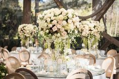 Garden Rose Centerpieces with Greenery    Photography: KLK Photography   Read More:  http://www.insideweddings.com/weddings/nature-inspired-alfresco-ceremony-tent-reception-at-malibu-ranch/811/