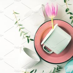 Spring crockery concept with tulips flowers pastel color. Arts & Entertainment Photos