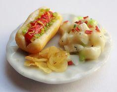 Mini clay salad, chips, and hotdog.