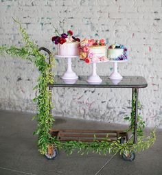 colorful floral ombre semi-naked cakes, dripping with frosting and accented with macarons
