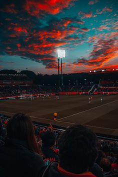 Soccer field under red sky Football Stadiums, Football Soccer, Street Football, Soccer Stadium, Football Girls, Escudo River Plate, Benfica Wallpaper, Parions Sport, Soccer Backgrounds