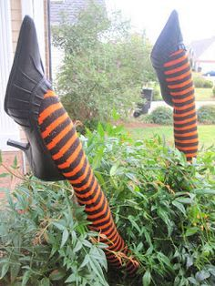Cover pool noodles with colorful stockings and add shoes. Perfect witches legs for Halloween decor.