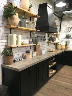 a rustic industrial kitchen with black cabinets and concrete countertops plus touches of light colored wood Kitchen 3 Kitchen Countertop Trends And 25 Examples Black Kitchen Cabinets, Black Kitchens, Cool Kitchens, Kitchen Black, Kitchen Shelves, Farmhouse Cabinets, Kitchen Pantries, Beige Cabinets, Open Cabinets