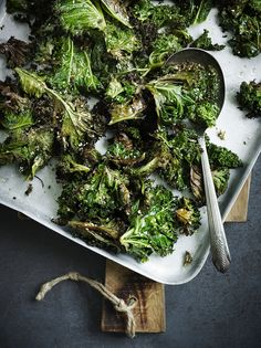 """Sesame-roasted kale """"Another one to convert doubters, kale has such a different quality when roasted, compared to boiled. It goes crisp and crackly in some parts, and tender in others. An easy side with a subtle Asian flavour. """""""
