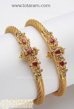 22 Karat Gold Kada with Rubies & Uncut Diamonds- 1 Pair Gross Gold Weight: 41.000 - 42.000 grams  Weight of Rubies: 2.0 Carats  Weight of Uncut Diamonds: 2.0 Carats  Minimum Width: 4.7 mm Maximum Width: 15.4 mm    Note: This item comes with a Screw and hinge so that you can open it up for easy wearing.