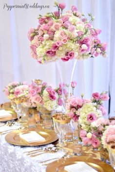 Pink and white wedding. Bridal show booth. Toronto's bridal show. head table arrangement. pink lisianthus, pink / majolika spray roses and white hydrangeas.