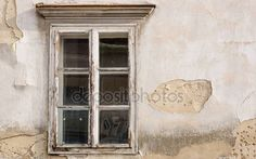Tiled wooden window on an old building — Stock Photo © WonderfulSnaps.com #148623245