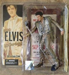 McFarlane ELVIS PRESLEY 1956 The Year In Gold ELVIS ACTION FIGURE #4 -6.5 In #McFarlaneToys Elvis Presley in 1956 The Year in Gold   McFarlane Toys action figure library brings to life the King of Rock 'n ' Roll in a classic pose and the gold outfit he wore during a New York city appearance in 1956. Accurately capturing Elvis' essence, this impeccably detailed figure includes a custom marquee base and mic stand.
