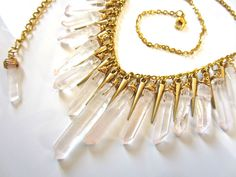 icicles - raw crystal statement bib necklace - wire wrapped raw quartz spikes necklace. $48.00, via Etsy.