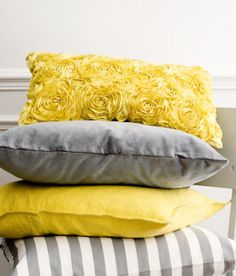 Yellow and grey are the best paired together! I love that top pillow!