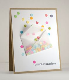 Confetti Congratulations Card.  Some paper scrap and punched paper in different colours (made with a regular office paper punch) and 'snip snap' - you've made a quick card for any celebration from Birthday to Wedding to Birth of a Baby etc etc.  Brilliant card and so easy to make.