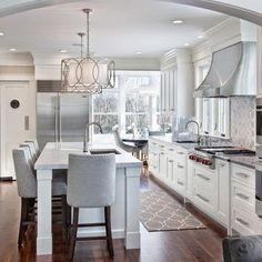 Note: Main sink opposite cooktop, prep sink under window; refrigerator at end of sightlineSouth Shore Decorating Blog: What I Love Wednesday: Summery Spaces