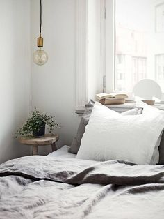 Using a small stool as a nightstand in the bedroom | Stadshem #homedecordiybedroom