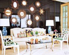 Glamorous mix of chinoiserie, blue & white china, brass mirror