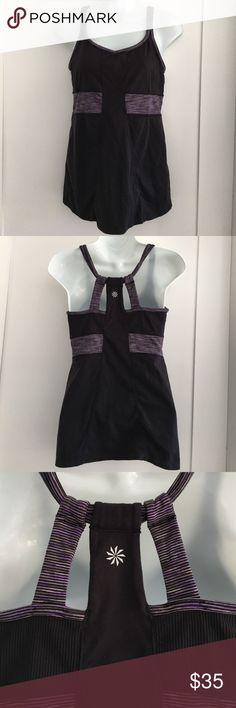Athleta Black and Purple Halter Top size S. Preowned lightly worn Athleta Black and Purple Halter Top size S. has built in bra and no pads. Please look at pictures for better reference. Happy shopping! CF Athleta Tops Tank Tops