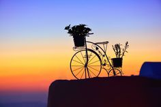 Bicycle in Oia - Santorini by Sabin Uivarosan  Oia (Greek: Οία, pronounced [ˈi.a]) is a small town and former community in the South Aegean on the islands of Thira (Santorini) and Therasia, in the Cyclades,