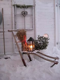 Vintage sled, window, garden tools in the snow