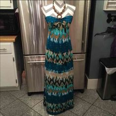 Super cute floor length dress In great shape. Stretchy. Wooden necklace. Nwot, never worn.   I have a clean, non smoking home. Items with tears or stain, any defects are NOT ever listed. I ship 6 days a week.   No trades, prices are firm unless bundled and I will always do the best I can on shipping prices for you :) Rue 21 Dresses