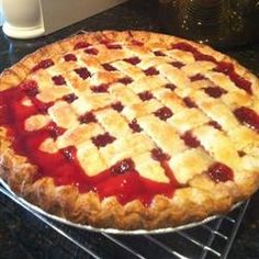 """""""This is a sour cherry pie recipe that is SO simple I can put it together and get in the oven in less than 10 minutes. The hardest thing about this pie is tracking down canned sour cherries but if you look carefully, you can find them in most grocery stores. When the pie is served, top with vanilla ice cream to add the element of sweet to the sour!"""""""