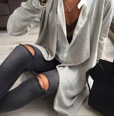 ripped jeans. white blouse. grey cardigan.