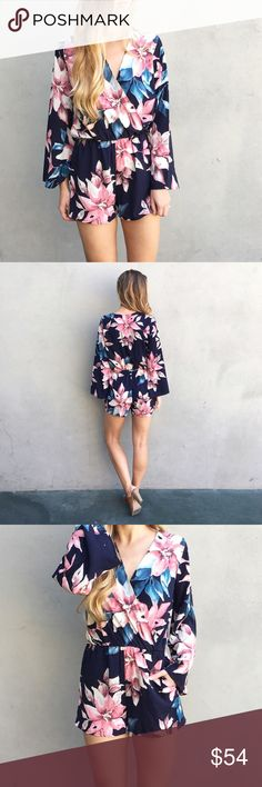 RESTOCKED | new | floral romper offers welcome new with tag navy surplice romper with floral print, flared sleeves, side pockets, and elastic waist. modeling size small. •651589•  instagram: @xomandysue Dresses Mini