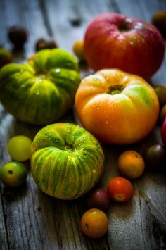 Heirloom tomatoes on rustic background by Alena Haurylik on 500px