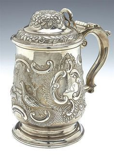 A GEORGE IV SILVER LIDDED TANKARD, JOSEPH CRADDOCK & WILLIAM REID, LONDON 1825 of baluster form on circular foot, the body chased with pheasants against a matt landscape, flowers and 'C' scrolls, the rococo cartouche engraved with a crest, the doubl