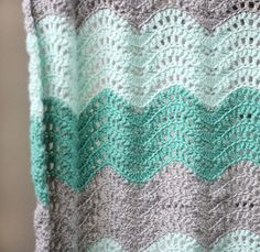 Here is another timeless and gorgeous baby blanket pattern! This blanket looks so snuggly and like the most comfortable and cozy blanket ever! This pretty, lacy Feather and Fan Baby Blanket designed by Alexis Middleton, works up quickly and has lots of great texture.This pattern is a mini version of the Chunky Feather and Fan …