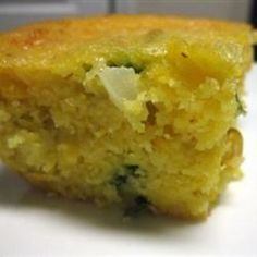 This buttermilk cornbread is thick with creamed corn, Cheddar cheese, fresh onion and jalapeno pepper. A melted Cheddar crust tops it off.