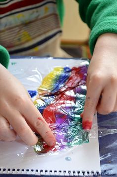 Put cling wrap on wet watercolor, pinch and scrunch. Once the paint is completely dry peel off the cling wrap and check out the cool effects!