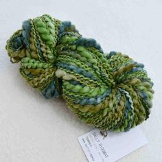 Shop Online chunky hand-spun art knitting yarn in Evergreen. Spun thick and thin and plied with a matching hand dyed strong silk thread.. Vibrant & rich colours in a chunky yarn perfect for knitting, crocheting, weaving, macrame and crafting into your next project. Australia wide and international postage available