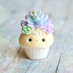 A succulent cupcake made for a recent custom order. He was actually supposed to have the dark sand/pebbles instead of the regular sand color so this little guy will be joining the other charms in my next shop update. I also have other custom charms that I've recently made and really can't wait to show yall! #polymerclay #claycharms #clay #charms #jewelry #food #foodie #cutefood #kawaiifood #handmade #diy #etsy #crafts #new #love #beautiful #cupcakes #succulentcupcakes #succulents #nature ...