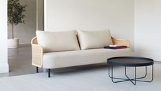 Our new Liana sofa collection reimagines rattan furniture for contemporary spaces. Available as a 2-seater, 3-seater and an armchair. Upholstered in New Zealand in your choice of fabric. Designed by industrial designer Scott Fitzsimons for Città.