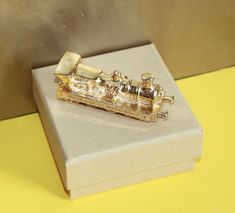 Train Shaped Gold Plated in Gift Box. Simplon Orient Express, Agatha Christie, Paper Weights, Costume Jewelry, Venice, Plating, Wedding Rings, Stud Earrings, Train
