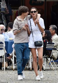 Sweet: Louis Tomlinson looked smitten as he wrapped his arm around girlfriend Eleanor Calder whilst they enjoyed a romantic holiday together in an Italian Riviera town on Wednesday