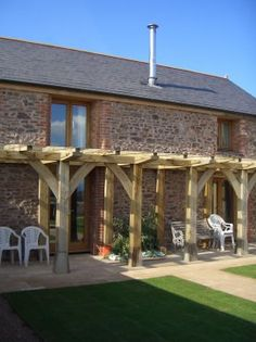 Oak frame veranda to make the most of the sunshine. By Roderick James Architects.