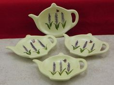 This is a set of four tea bag holders.They are approximately 3 1/4 X 4 1/4 hand painted in our lavender and ladybug design with a celery green under glaze background. This makes a great gift. They can be used as a tea bag holder, a place to put your spoon or a brillo holder. We cast them in stoneware slip, under glaze in lead free glaze then they are fired and glazed in our lead free glaze and are fired again. They are dishwasher safe. Made in the U.S.A. Pa. residents please add 6% ...