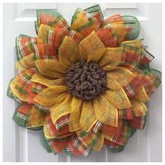 "Thank you for looking at this beautiful poly burlap Sunflower Wreath! It's made from poly burlap which is a great weather resistant product. This particular Wreath will measure out to about 27""-28"" in diameter. This is a great way to decorate your door from spring to fall time."
