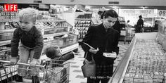 A working mother shops with her children at the super market in 1956