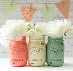 Set of 3 mason jars painted and distressed in mint green, coral, and cream. Perfect for weddings and showers, centerpieces, flowers, shelf and