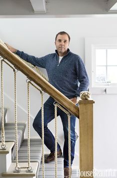 Boston designer Frank Roop poses on the stairwell. Read more about his inspiration for the home here. For more details, see resources. This story originally appeared in the July/August 2016 issue of House Beautiful.