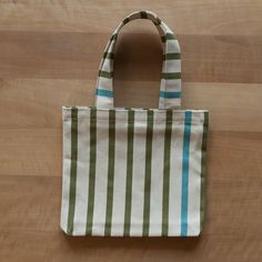 Bottle bag for 2 bottles. 100% cotton. 22x25 cm. Handmade in Switzerland an France. Colors: beige, olive, turquoise