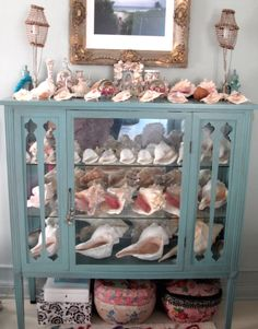 DisPlay Y0Ur TreasUres in an Old glass cabineT... shells or shoes... it's all the same! Nice!