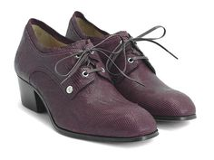 """He might not ever boast about it, but for John, every finished shoe design is a real victory. Fittingly named after the Gate of Triumph in Laos, The Patuxai is a pretty, polished lace up shoe with metal eyelets and a silver JF Angel stud. Classic good looks and a low 2"""" stacked leather heel make them an easy addition to any collection.Ask and you shall receive.Made in Portugal Smooth and specialty leathers Blake constructed Stacked 2"""" leather heel Flat cotton laces"""