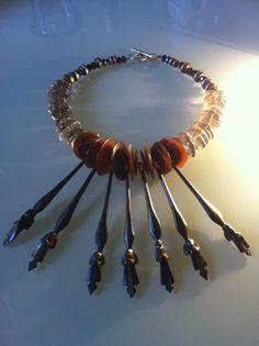 ANEHO Création necklaces:  Collier composé de piques de coiffes en ébène (Afrique), rondelles en écaille de tortue (Polynésie), rondelles de quartz fumé (Brésil) et perles en bois incrusté (Mali).