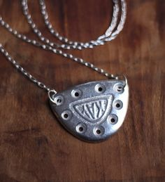 A necklace made from a vintage metal tap. $68 on Etsy < if your'e gonna get me a gift, here's what I want ;P