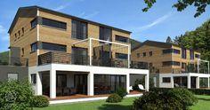 Ein Haus im Haus, das Mehrfamilienhaus auf engem Raum von Baufritz. Platzsparend und wohngesund planen und bauen.